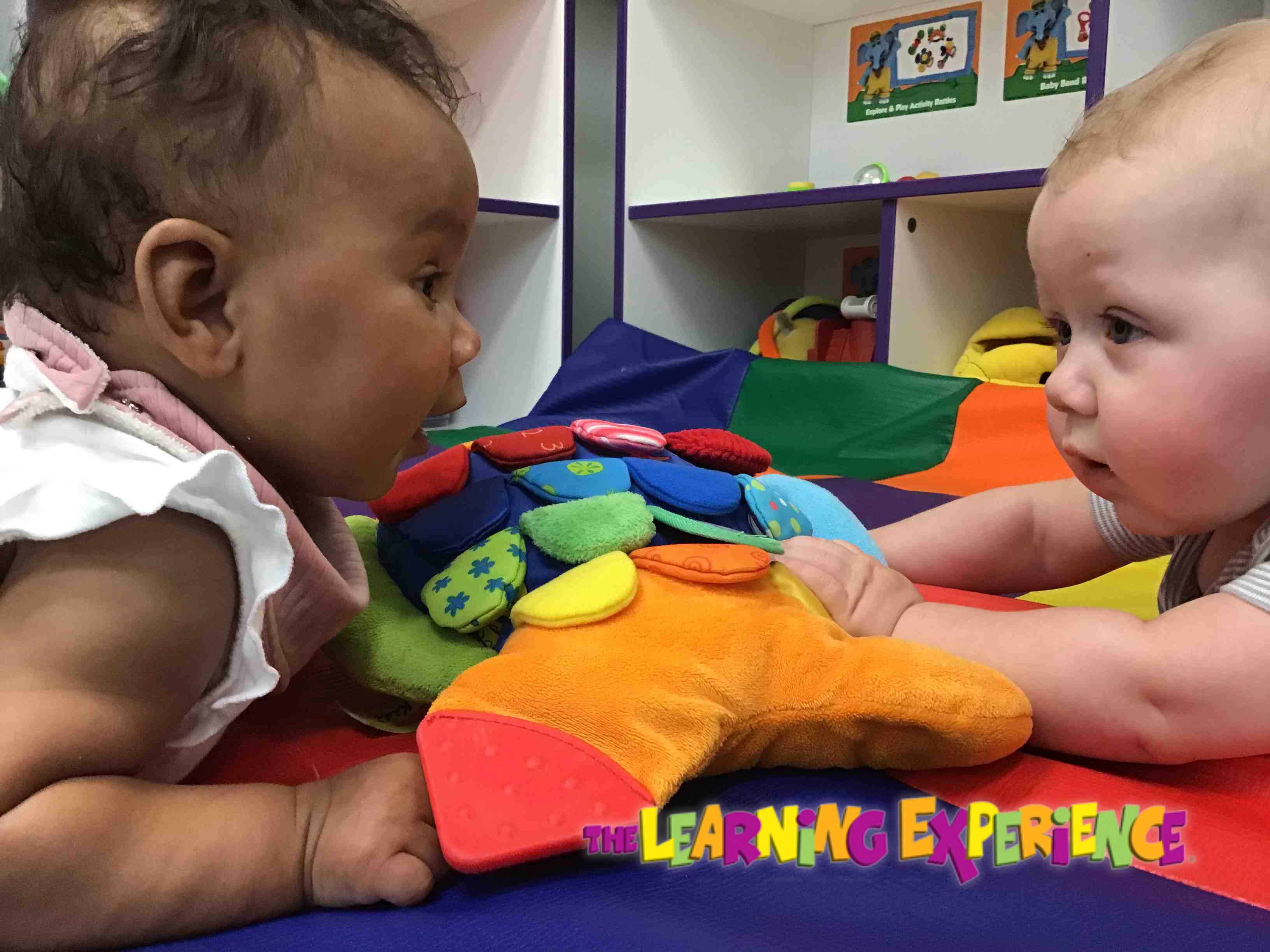 Tummy time is a perfect place to make friends.